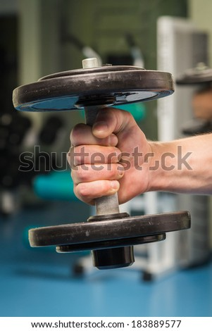 man doing exercises with dumbbell - stock photo
