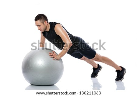 Man doing fitness exercise on pilates ball - stock photo