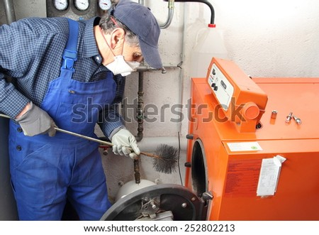 Man doing maintenance of a central heating system - stock photo