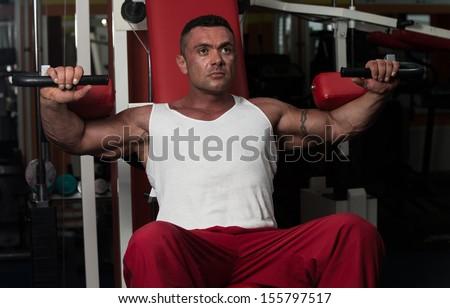 Man Doing Shoulder Exercises - stock photo