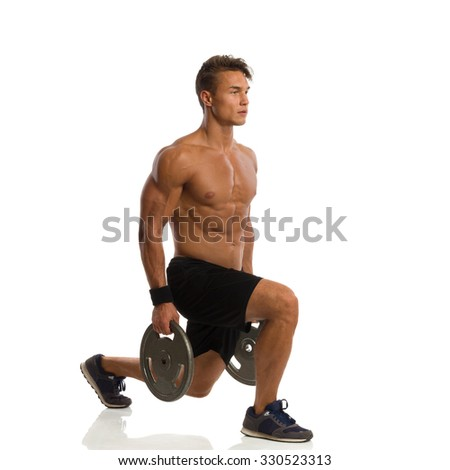 Man Doing Split Squat With Weights. Side View - stock photo