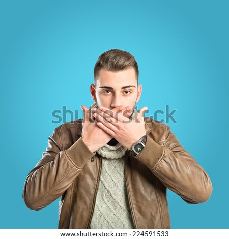 Man doing surprise gesture over wbluehite background - stock photo