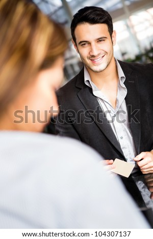 Man doing the check in at a hotel - stock photo