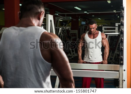 Man Doing Trap Exercises - stock photo