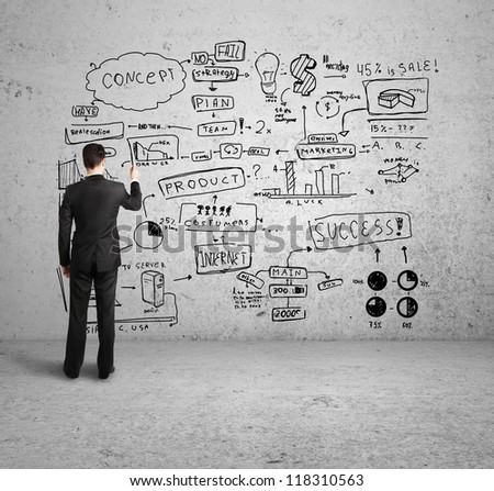 man drawing business  concept on concrete wall - stock photo