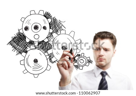 man drawing gears on a white background - stock photo