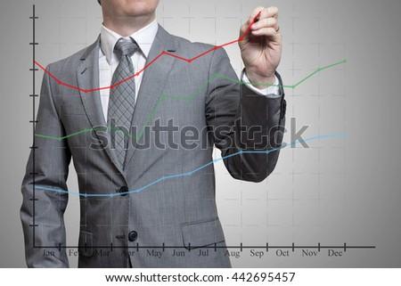 man draws a graph - stock photo