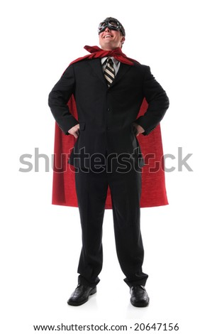 Man dressed in suit, cape and goggles standing confidently - stock photo