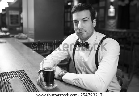 Man dressed in vinrtage style in bar - stock photo