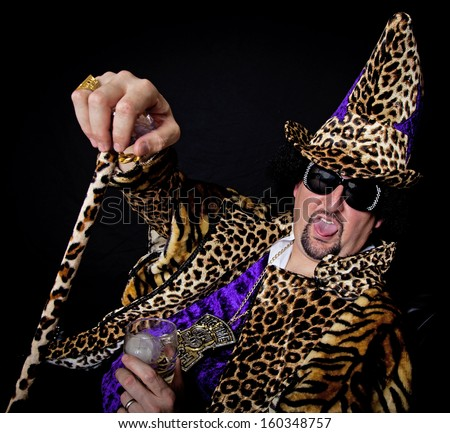 Man dressed up in a pimp costume for halloween - stock photo