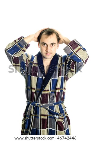 Man dressing blue bathrobe and hands up isolated on white background - stock photo