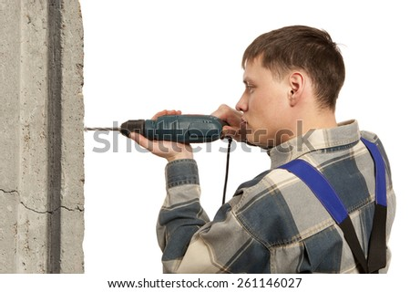 Man drilling hole in wall - stock photo