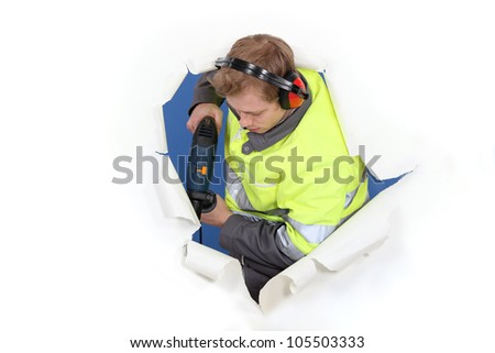 Man drilling through background - stock photo
