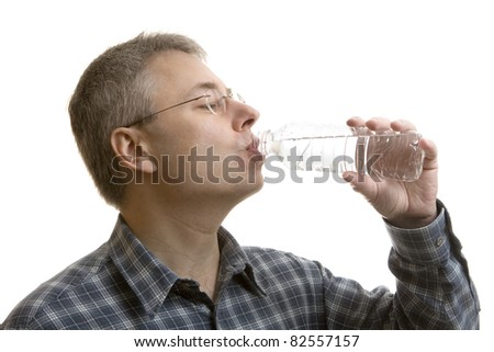 Man drinking bottled water - stock photo