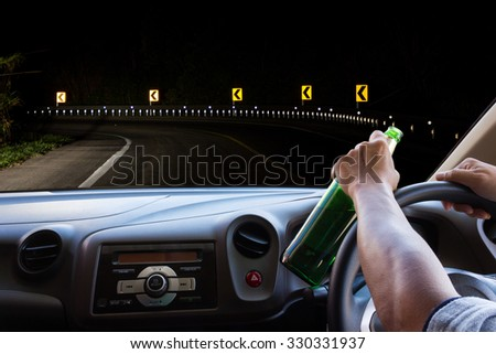 Man drinking while driving . - stock photo