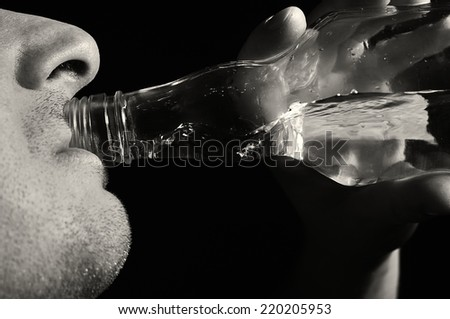 Man drinks vodka. Alcoholic. MANY OTHER PHOTOS FROM THIS SERIES IN MY PORTFOLIO. - stock photo