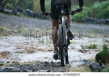 man drive mountain bike over water river - stock photo