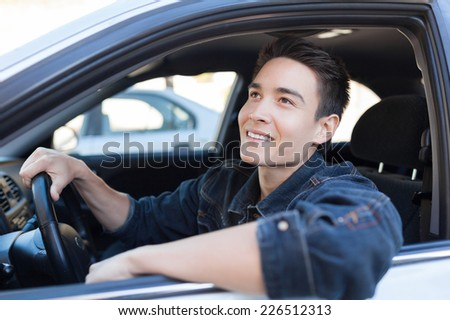 Man driver driving a car - stock photo