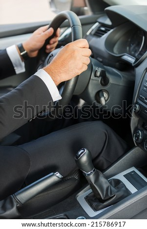 Man driving a car. Close-up of man in formalwear driving car  - stock photo