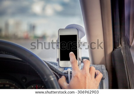Man driving and using phone,smart phone,tablet,cellphone in car - stock photo