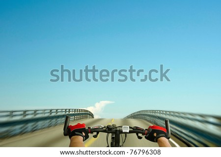 Man driving bicycle on the road - stock photo