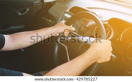 Man driving car. - stock photo