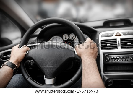 Man driving his car. Hands holding the wheel.  - stock photo