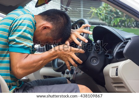 Man drunk contraction bent and warped look inside his car accident which fractured windshield. - stock photo
