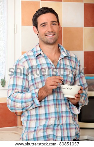 Man eating cereal - stock photo
