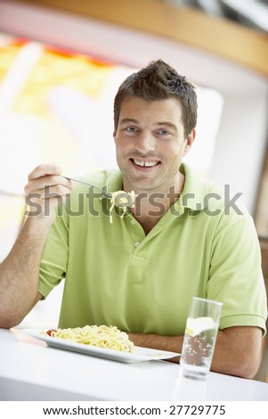 Man Eating Lunch At A Cafe - stock photo