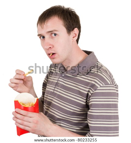 man eats French fries isolated on white - stock photo