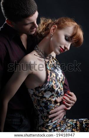 Man embrace woman - stock photo