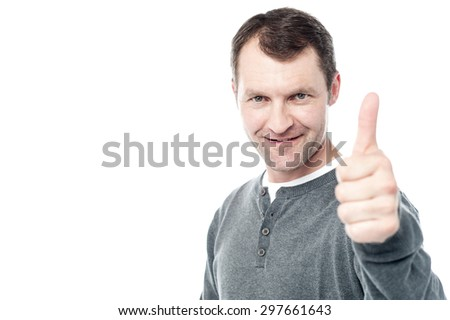Man encouraging by showing thumbs up gesture - stock photo