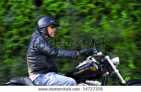Man enjoys his Sunday afternoon ride on his motorbike - stock photo