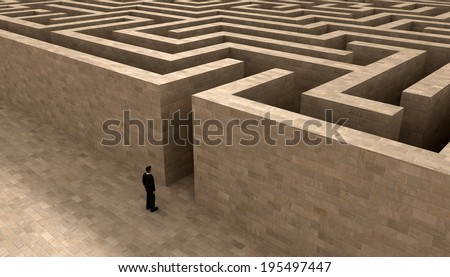 man entering the labyrinth - stock photo