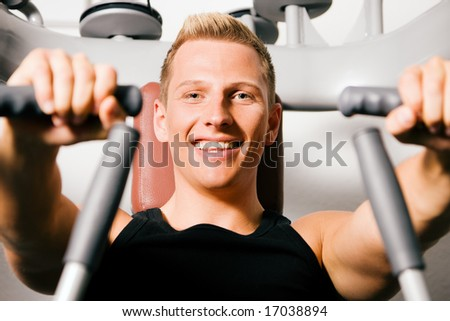 Man exercising in the gym - stock photo