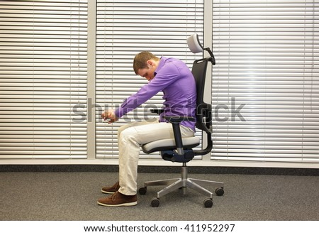 man exercising on chair in office, healthy lifestyle -profile - stock photo
