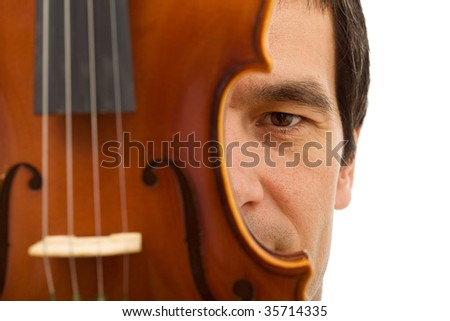 Man face hidden behind violin detail - closeup, isolated - stock photo