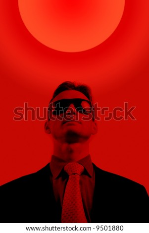 man face with sunglasses in dark red - stock photo