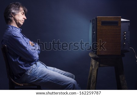 man fell asleep watching TV. - stock photo