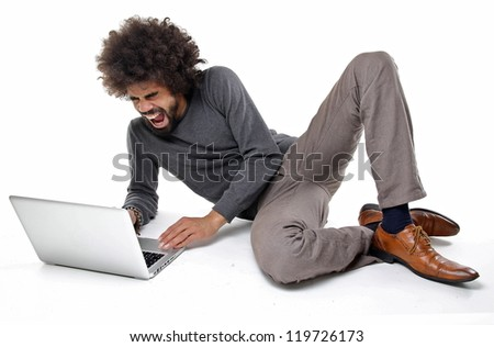 Man fighting with hist laptop - stock photo