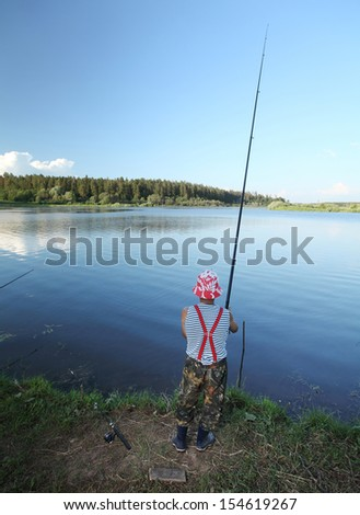 Man fishing in a pond - stock photo