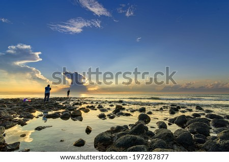 Man fishing in the morning when the sun rising up - stock photo