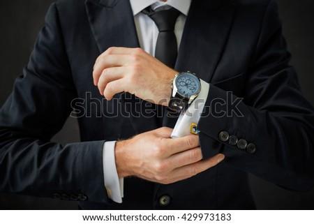 Man fixing his shirt sleeve  - stock photo