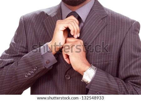 Man fixing his tie - stock photo