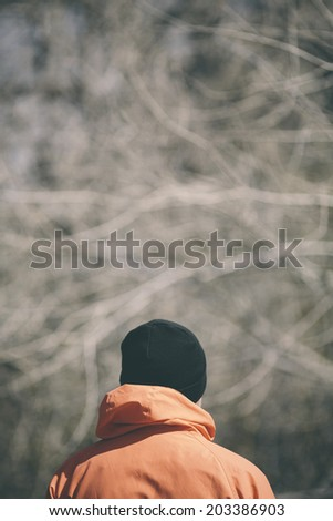 man from behinde deep in the forest - stock photo