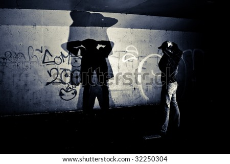 Man getting arrested with hand in his neck - stock photo