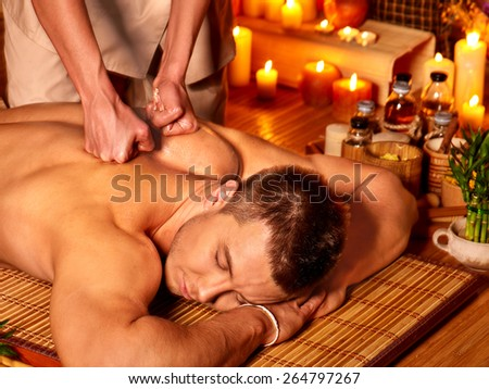 Man getting massage in spa. Female therapist. - stock photo