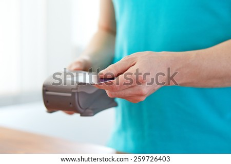 Man gives a credit card to pay, in the shop - stock photo