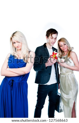 man gives a gift to a woman, while others ignore - stock photo